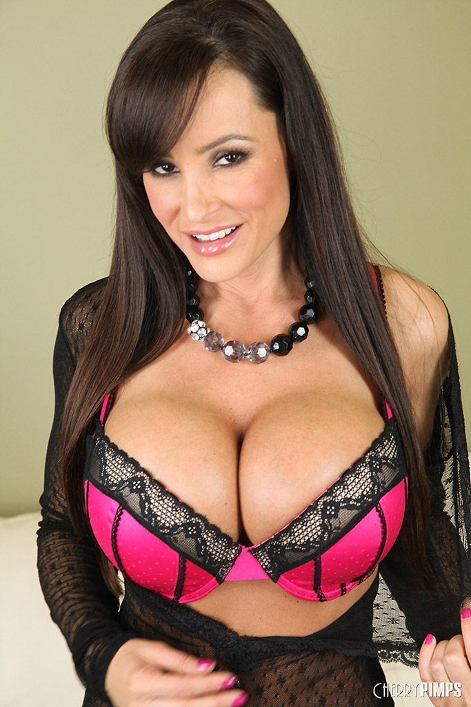 Lisa Ann Caresses her Huge Boobs and Works her Dildo