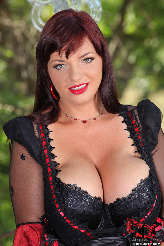 Joanna Bliss Busts Out of Her Black Lingerie
